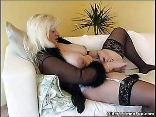 Chubby housewife in stockings plays with new sex toy stockings