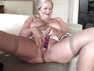 Granny April undresses and savorily jerks off her age-old cunt fingering